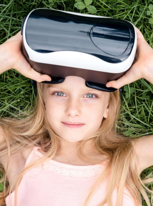 Girl in nature with VR-Headset